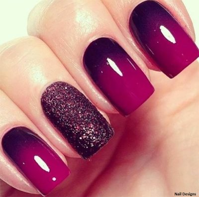 Purple and black colored, embossed nail